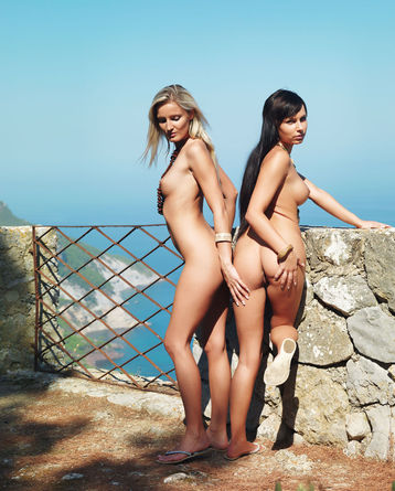 Carie And Paola Posing Naked By The Sea