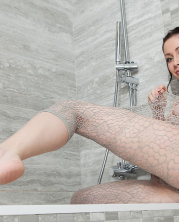 Black Haired Girl In Fishnet