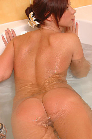 Hot assed redhead in the bathtub