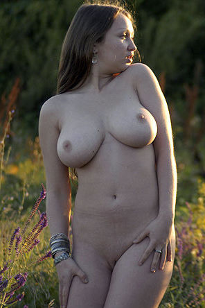 Big natural boobs by the field